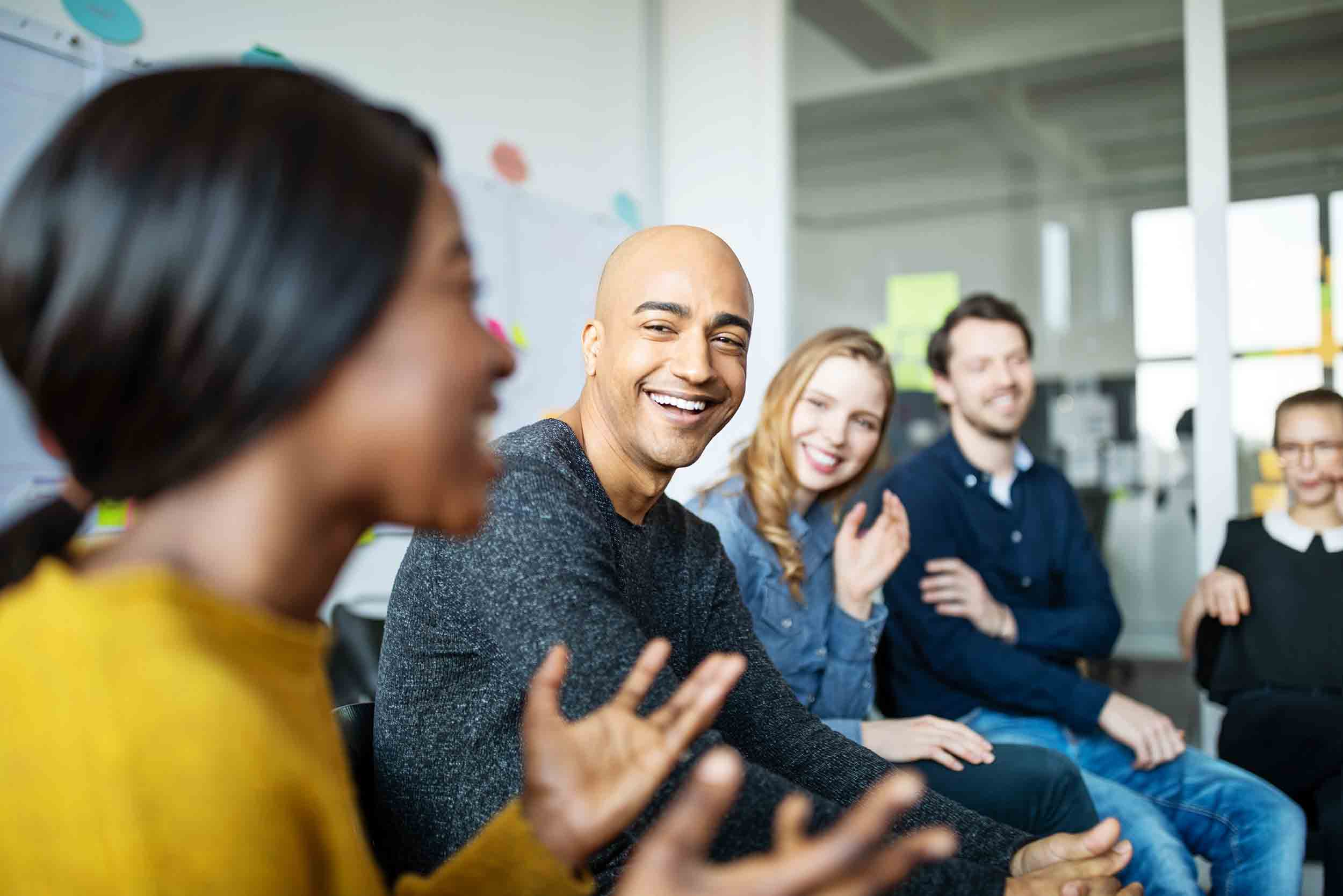 Business team smiling during a meeting